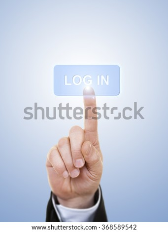 Hand simulating pressing log in button with index finger, on a blue background.