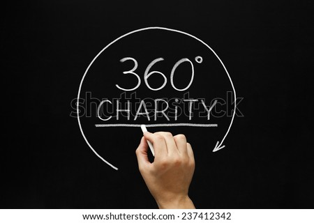Hand sketching 360 degrees Charity concept with white chalk on a blackboard.  - stock photo