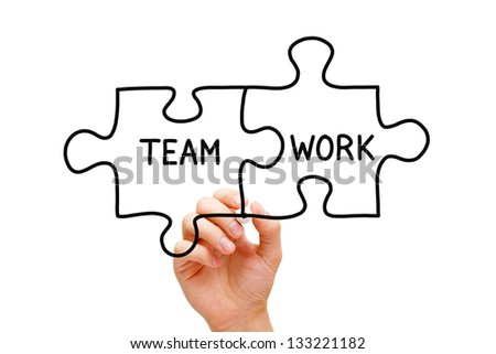Hand sketching Teamwork Puzzle Concept with black marker on transparent wipe board. - stock photo