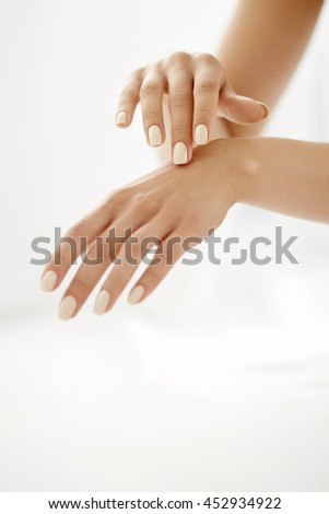 Hand Skin Care. Closeup Of Beautiful Female Hands With Natural Manicure Nails. Close Up Of Woman's Hand Touching Her Soft Silky Healthy Skin. Beauty And Health, Body Care Concept.