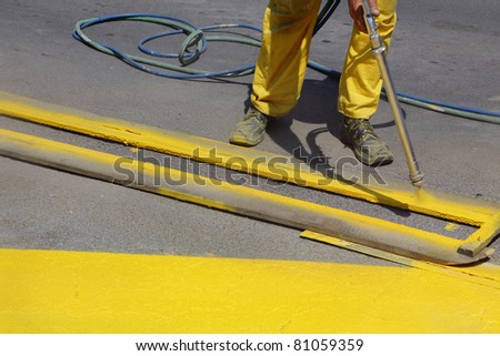 Hand spraying of bus station at a street - stock photo