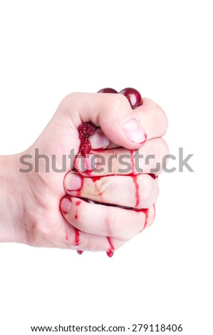 hand squeezes out juice from sweet cherry berries - stock photo