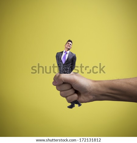Hand squeezing a young businessman