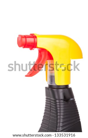 hand squirting a bottle of cleaning spray isolated on white
