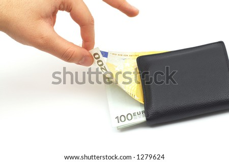 hand stealing from leather wallet - stock photo
