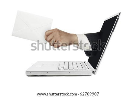 Hand sticking out from computer with mail. - stock photo