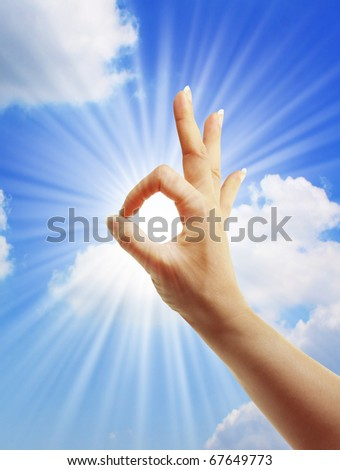 hand sun and blue sky with  showing freedom or solar power concept - stock photo