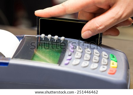 Hand Swiping Blank Credit Card In Store - stock photo