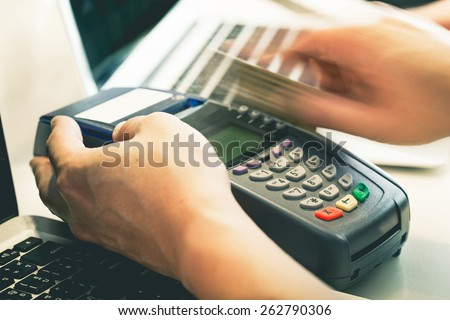 Hand Swiping Credit Card In Store : Still-Life Processed - stock photo