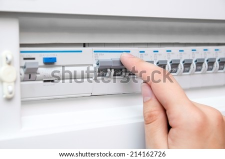 Hand switch electric fuse - stock photo