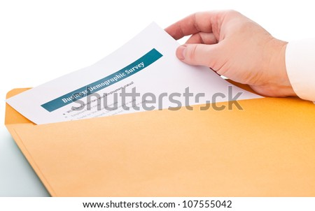 hand takes the paper from the envelope