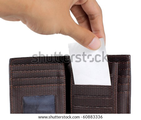 hand taking card inside brown wallet - stock photo