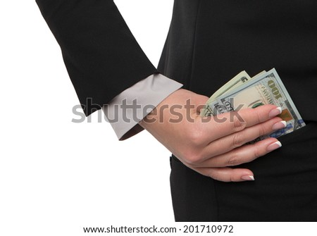 Hand taking some money out of pocket - stock photo