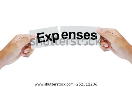 Hand tearing the word Expenses - stock photo