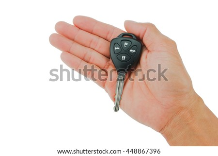 Hand the car keys on isolate white background