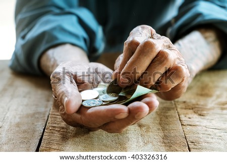 Hand the old man and pile coin for saving. money saving concept.  - stock photo
