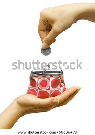 Hand throwing coin in purse on white background - stock photo