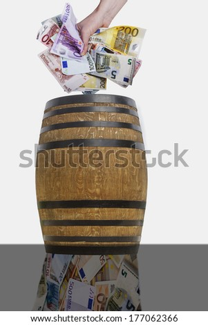 Hand throwing crumpled bills into the barrel - stock photo
