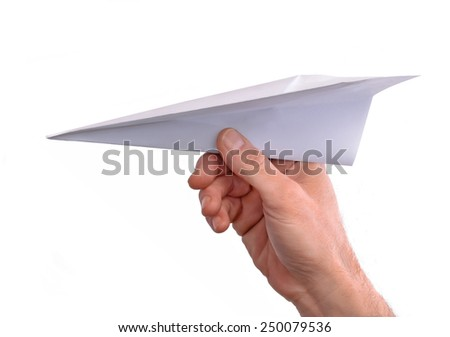 Hand throwing paper plane isolated on white background. - stock photo