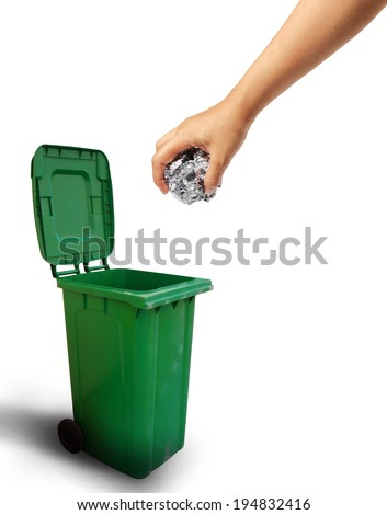 Hand throwing paper recycle into the trash, ecology concept.  - stock photo