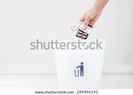 hand throwing pills away. Health concept - stock photo