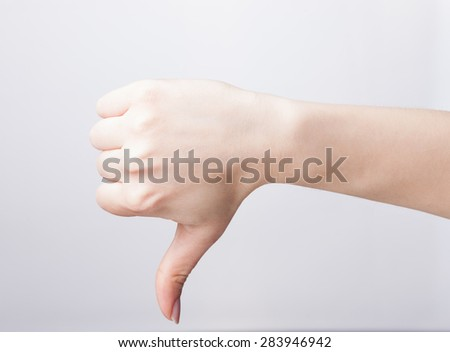 Hand thumb down isolated on white background. - stock photo