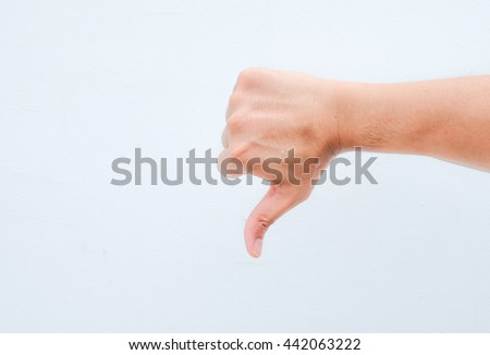 hand thumb down on white background