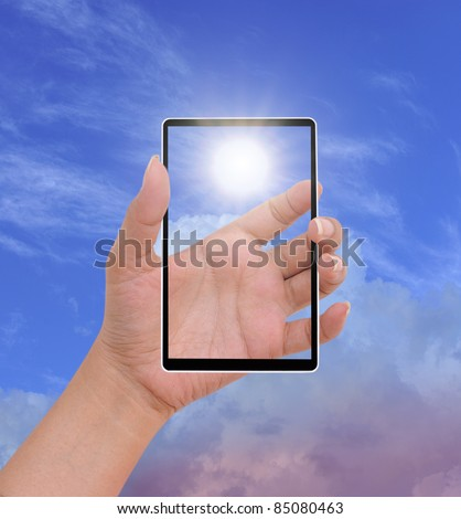 Hand to hold card, mobile phone, tablet PC on blue sky