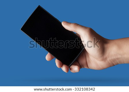 Hand to hold mobile phone. High resolution - stock photo