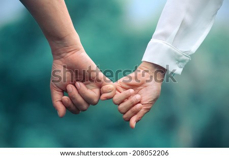hand  to pinky swear vintage style - stock photo
