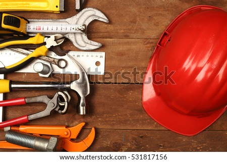 Hand tools and helmet on a workbench