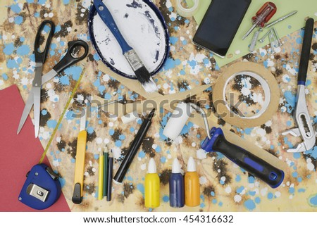 Hand tools, paint colors and paddle roller for house remodeling and renovation - stock photo