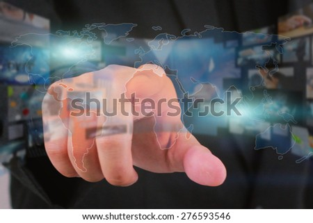 Hand touch on virtual screen. - stock photo