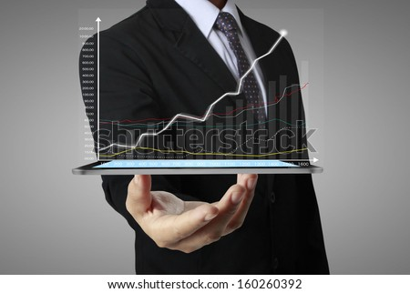 hand touch screen graph on a tablet  - stock photo