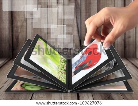 Hand touch screen tablet streaming images - stock photo