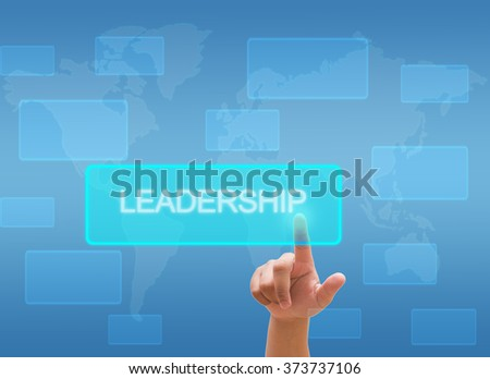 "hand touching ""LEADERSHIP"" on virtual screen interface"