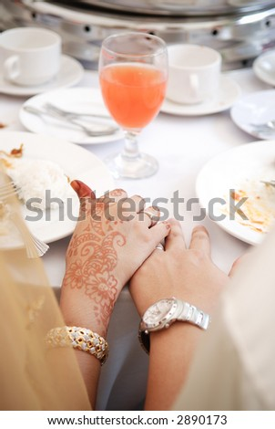 Hand touching of bride and groom - stock photo