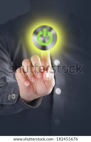 Hand touching power button  - stock photo