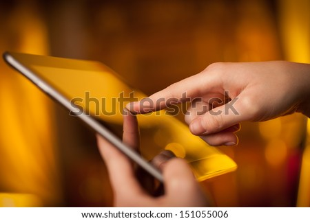 Hand touching tablet pc with copy space - stock photo