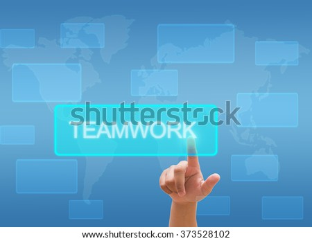 "hand touching  ""teamwork""  on virtual screen interface - stock photo"