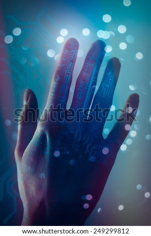 Hand touching virtual circuit board in the background. Cyberpunk, toned image. - stock photo