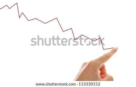 hand tracing a falling graph symbol for a shrinking business - stock photo