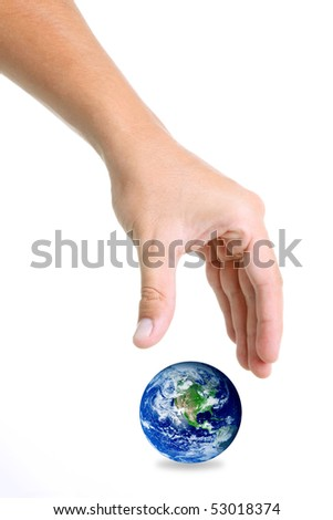 Hand trying to catch the world over white background - stock photo