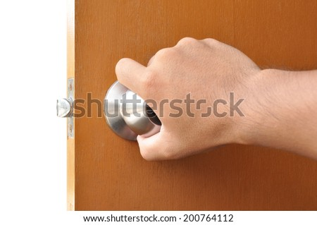 Hand turning the door knob