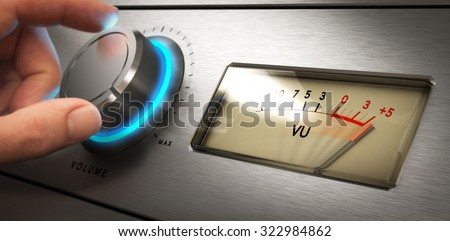 Hand turning the volume knob of an amplifier up to the maximum, Concept image for noisy environment or hearing problems - stock photo