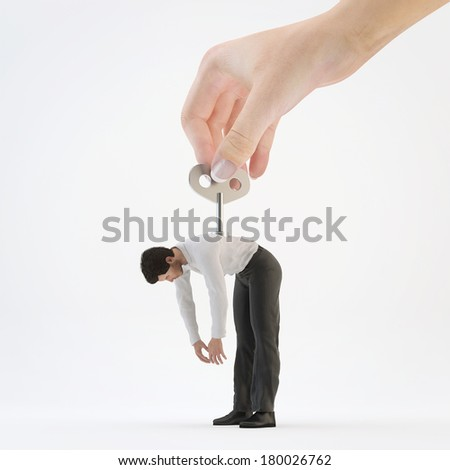 Hand Turns clockwork on the back of   businessman. Concept to stimulate work - stock photo