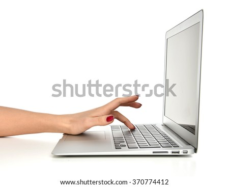 Hand typing on keyboard computer laptop with blank copy space screen in an office at a workplace on a white background - stock photo