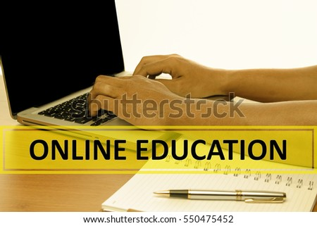 Hand Typing on keyboard with text ONLINE EDUCATION