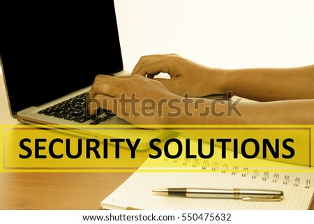 Hand Typing on keyboard with text SECURITY SOLUTIONS