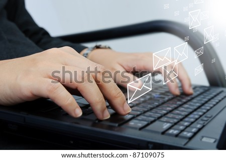 Hand typing on laptop computer keyboard